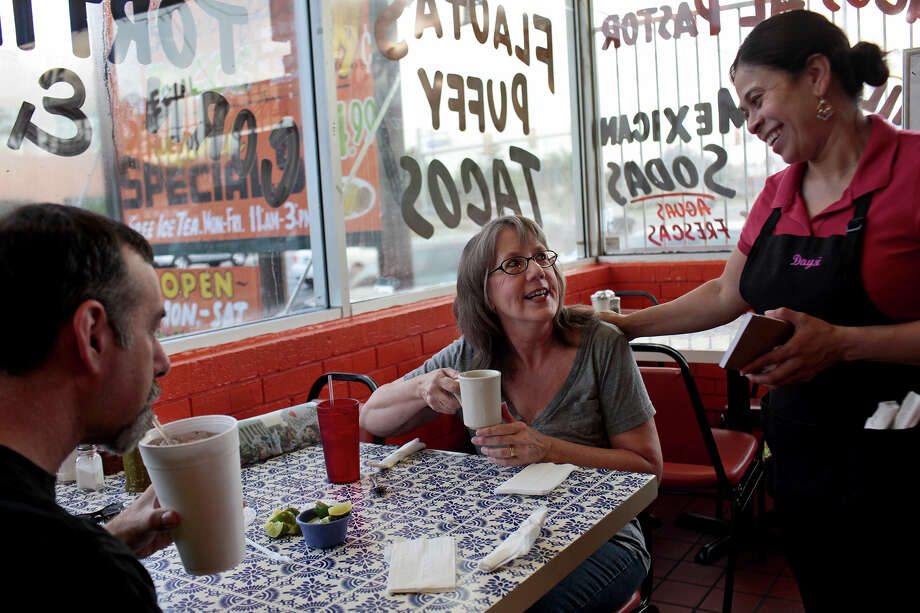 "Judy Greenberg and her husband, Mark Greenberg, laugh with waitress Daysi Vasquez, right, during their weekly ""Taco Friday breakfast date at Carmelitas Mexican Restaurant in San Antonio on Friday, June 29, 2012. Photo: Lisa Krantz, San Antonio Express-News / San Antonio Express-News"