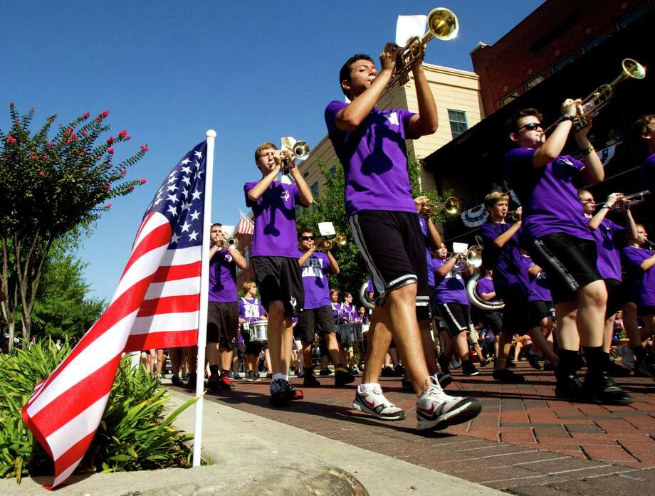 The Willis High School Marching Band perform as they march in the annual Fourth of July Parade at Market Street Wednesday, July 4, 2012, in The Woodlands. Photo: Brett Coomer, Houston Chronicle / © 2012 Houston Chronicle