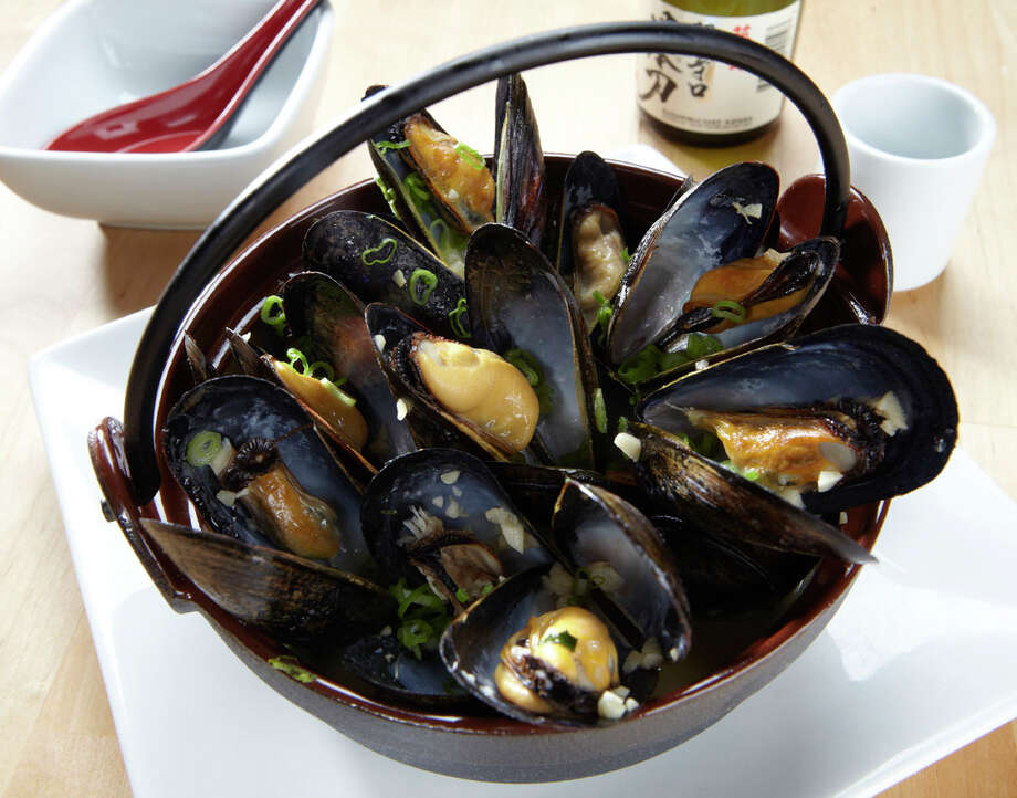 Drunken Black Mussels at RA Sushi are steamed in sake, sautéed in garlic and seasoned with soy sauce. Photo: Courtesy Photo