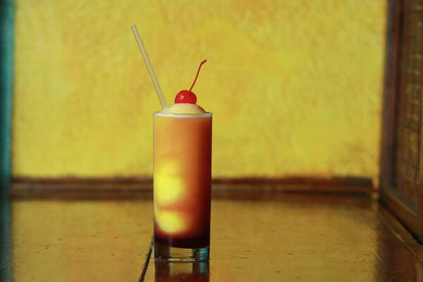 (For the Chronicle/Gary Fountain, June 30, 2012) A Swirl Screwdriver with Cherry, at Under the Volcano.