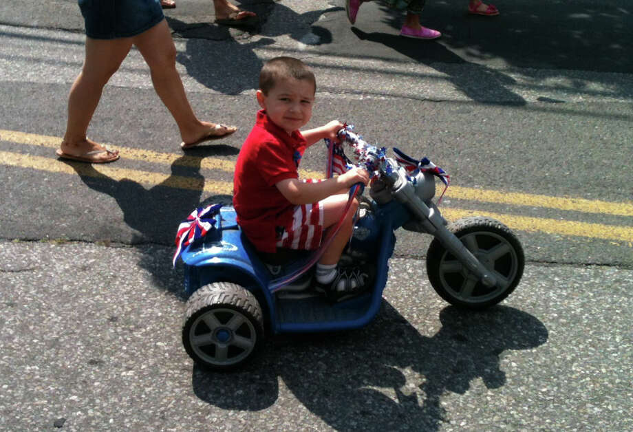 A youngster cycles down Pequot Avenue on Wednesday during the annual Bicycle Parade and Picnic sponosred for Independence Day by the Pequot Library. Photo: Andrew Brophy / Fairfield Citizen contributed