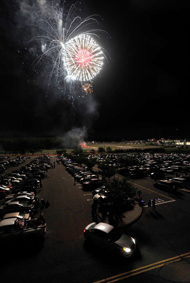 The Danbury Fair mall-sponsored fireworks were set off from the Danbury Municipal Airport on Tuesday, July 3, 2012. Photo: Jason Rearick / The News-Times
