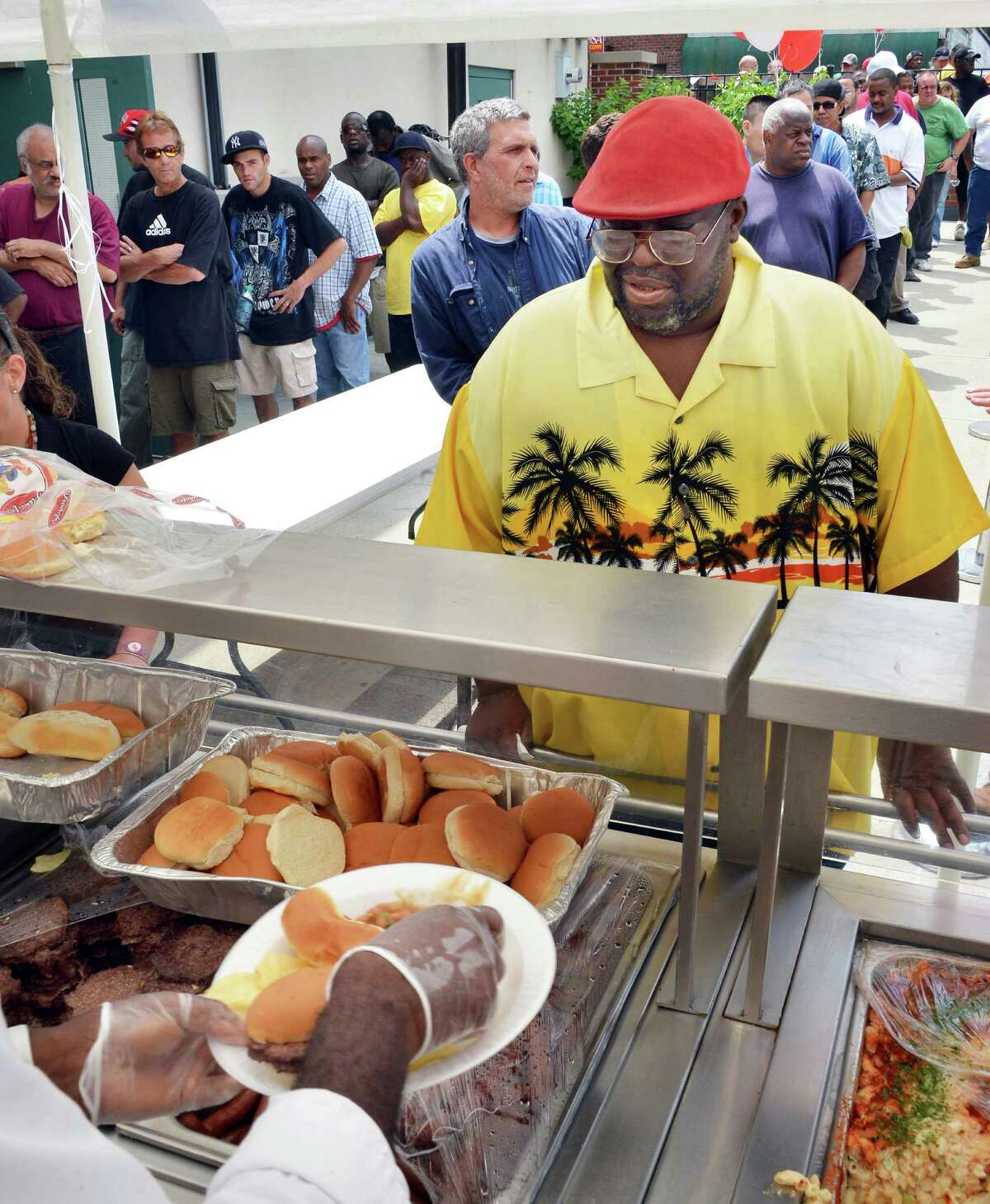 Ike Carter of Albany helps celebrate the Fourth of July at the Capital City Rescue Mission's holiday picnic and health fair in Albany Wednesday July 4, 2012. (John Carl D'Annibale / Times Union)