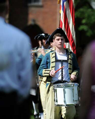 Connor Frawley leads the procession of colors Wednesday, July 4, 2012 at the 119th annual Independence Day Celebration at Town Hall in Fairfield, Conn. Photo: Autumn Driscoll / Connecticut Post