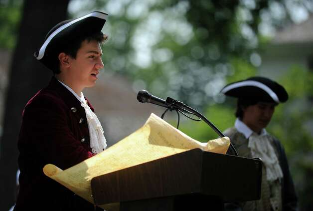 Max Rein, representing Thomas Jefferson, reads from the Declaration of Independence Wednesday, July 4, 2012 at the 119th annual Independence Day Celebration at Town Hall in Fairfield, Conn. Photo: Autumn Driscoll / Connecticut Post