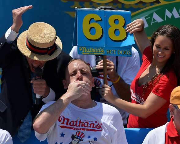 Five-time Nathan's Famous Champion Joey Chestnut wins his sixth title by equaling his record of 68 hot dogs and buns in ten minutes during Nathan's Famous Fourth of July International Hot Dog Eating Contest July 4, 2012 in the Coney Island section of New York. Photo: Stan Honda, AFP/Getty Images
