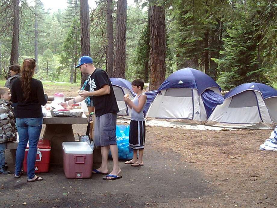 Family camping at Fowler's Campground on upper McCloud River in Shasta-Trinity National Forest. Photo: Tom Stienstra, The Chronicle