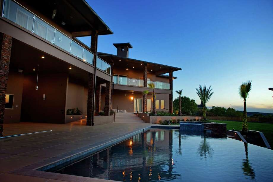 Diamante Custom Homes built this contemporary home in The Dominion. Builders say that it has been difficult to get more modern home designs approved by developers and homeowners associations, but that is slowly changing. Photo: Courtesy Photo / Courtesy of Diamante Custom Homes