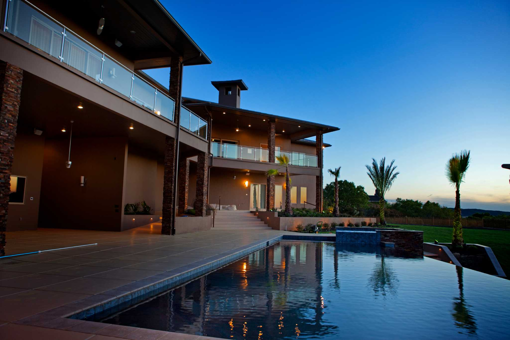Modern designs catching on with high end homes san for Modern home builders san antonio