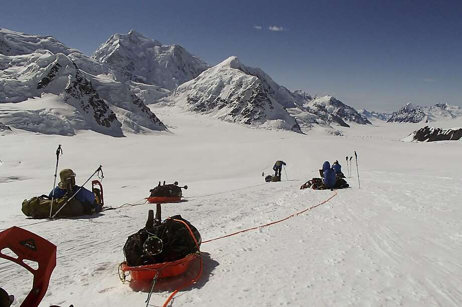 In this June 13, 2012, file photo provided by Disabled Sports USA, members of Warfighter Sports Denali Challenge pull gear while attempting to climb Mount McKinley in Alaska. The five men, all severely wounded in war, including four who had amputations, had to abandon their climb of North America's tallest peak, but say it was weather and not their disabilities that ended the summit attempt. The five men descended Alaska's Mount McKinley on Monday, July 2. (AP Photo/Disabled Sports USA, File) Photo: Associated Press