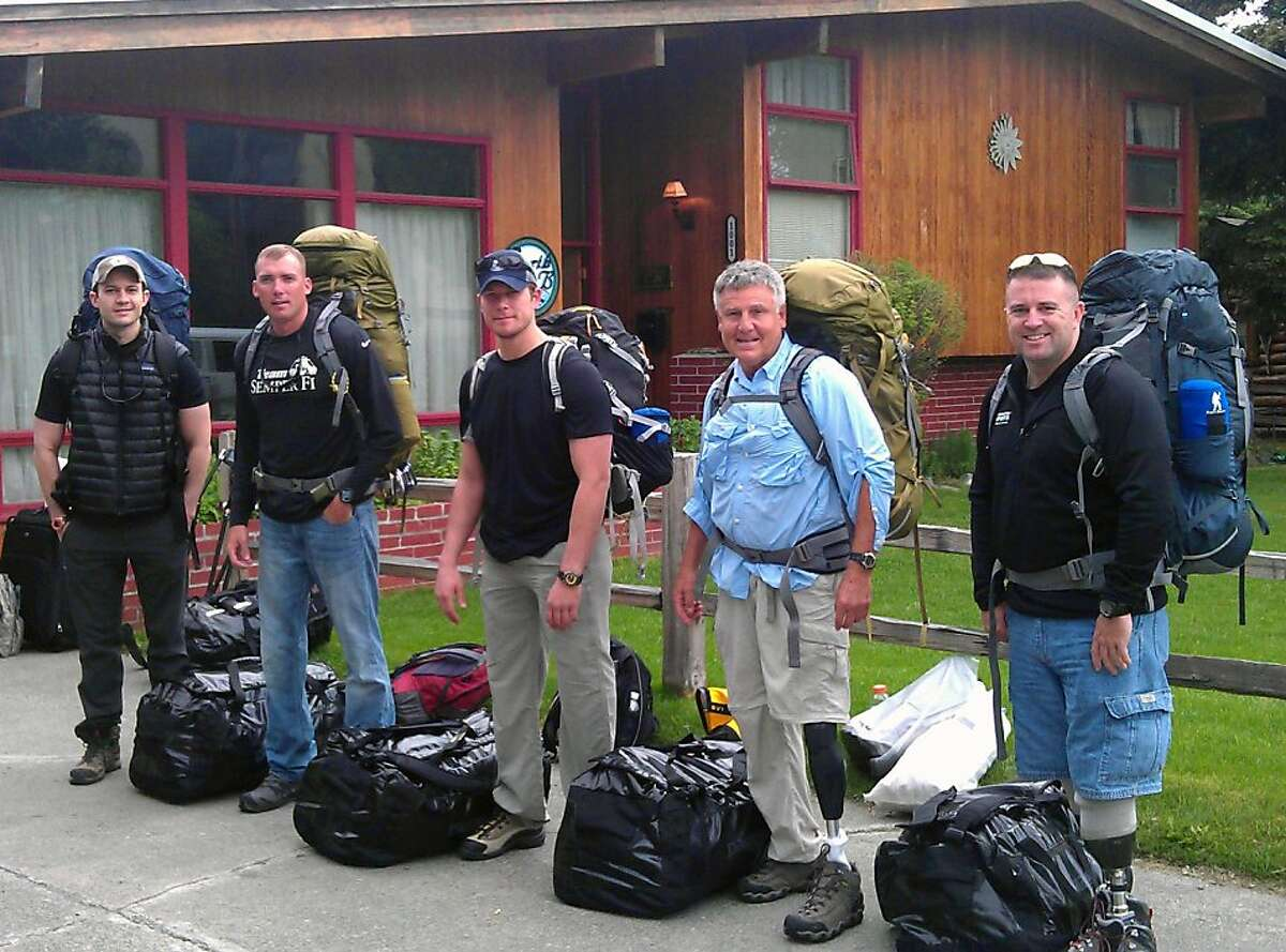 In this June 11, 2012, file photo provided by Disabled Sports USA, Jesse Acosta, from left, David Borden, Neil Duncan, Kirk Bauer and Steve Martin, members of Warfighter Sports Denali Challenge, pose for a photograph in Anchorage, Alaska. The five men, all severely wounded in war, including four who had amputations, had to abandon their climb of North America's tallest peak, but say it was weather and not their disabilities that ended the summit attempt. The five men descended Alaska's Mount McKinley on Monday, July 2. (AP Photo/Disabled Sports USA, File)