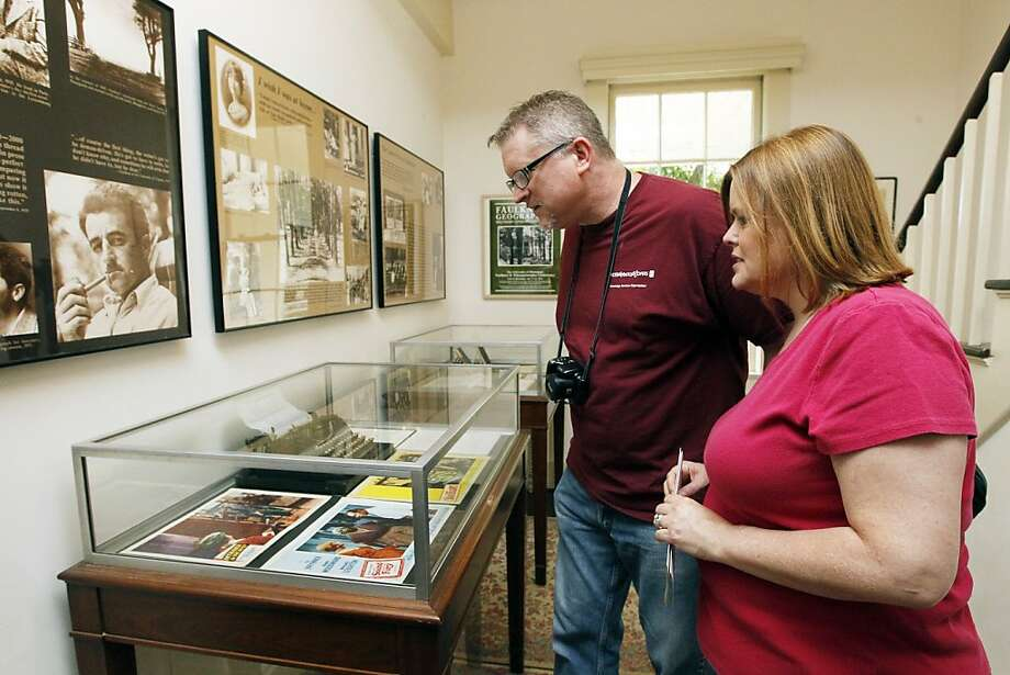 In this June 8, 2012 photograph, Lisa McDanels and her husband Kendall Christian of Rocky River, Ohio, inspect the display cases at Roan Oak, the home of the late Nobel Prize laureate William Faulkner, in Oxford, Miss. The home is now owned and maintained by the University of Mississippi as a museum.  (AP Photo/Rogelio V. Solis) Photo: Rogelio V. Solis, Associated Press