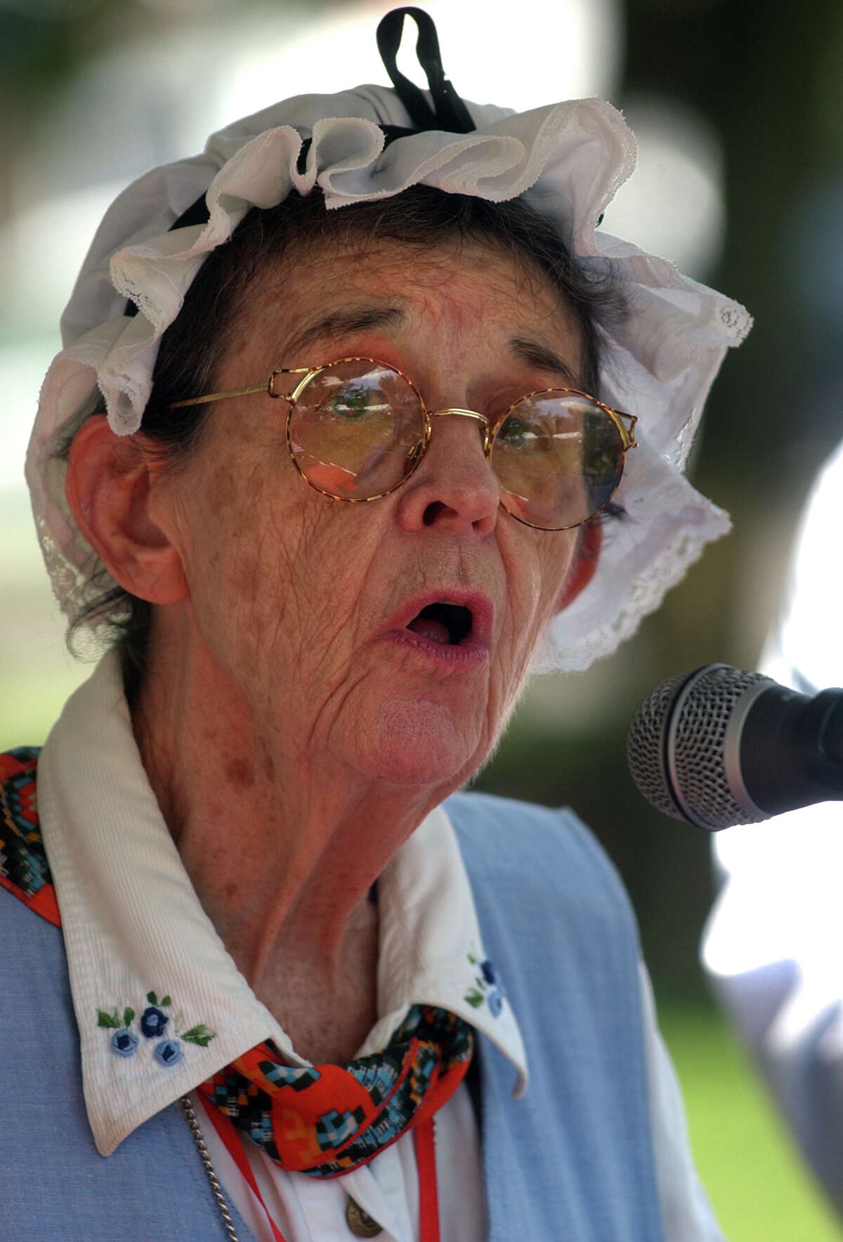 Rosemary Scarpa sings the Star Spangled Banner, during bell ringing ceremony to celebrate Independence Day, which was held on the green in Milford, Conn. on Wednesday July 4, 2012. Accompanying her on piano was Joe Mele.