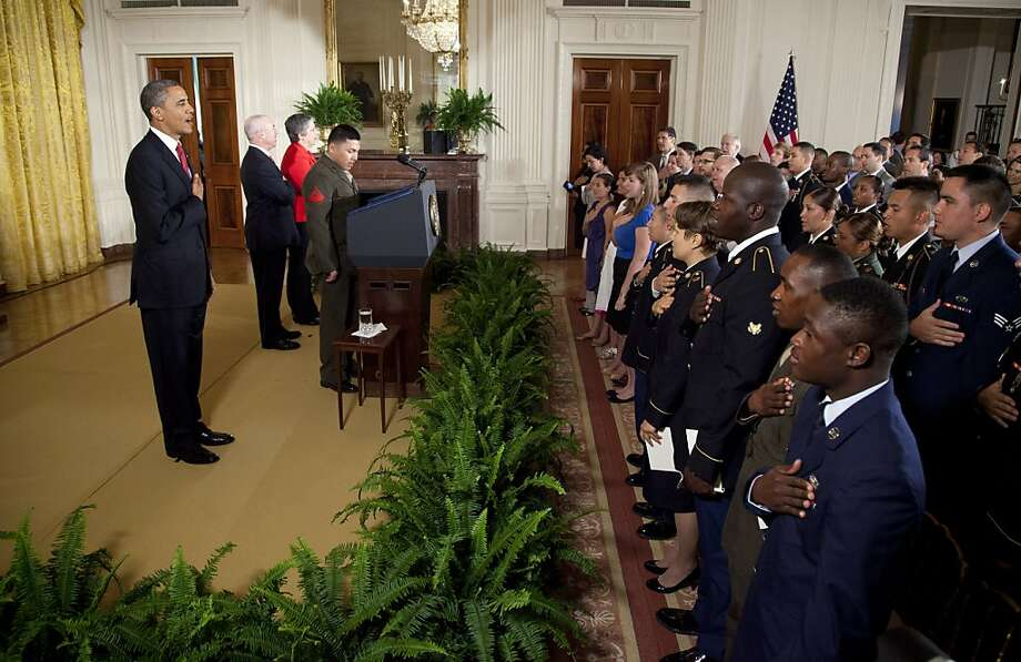 President Barack Obama says the Pledge of Allegiance during a naturalization ceremony for active duty service members in the East Room of the White House in Washington, Wednesday, July 4, 2012.  (AP Photo/Evan Vucci) Photo: Evan Vucci, Associated Press