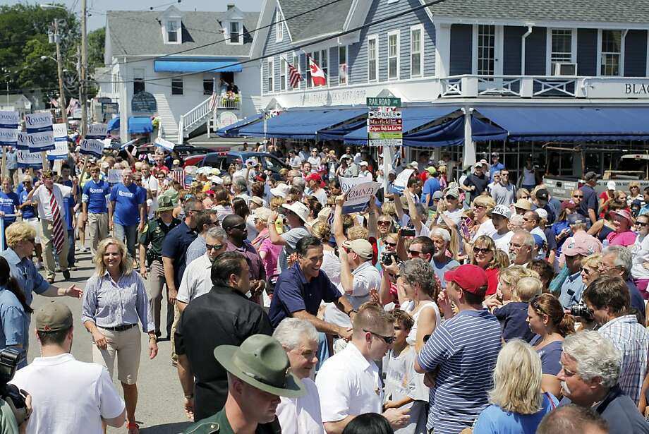 Republican presidential candidate, former Massachusetts Gov. Mitt Romney greets the crowd as he walks in the Fourth of July Parade in Wolfeboro, N.H., Wednesday, July 4, 2012. (AP Photo/Charles Dharapak) Photo: Charles Dharapak, Associated Press