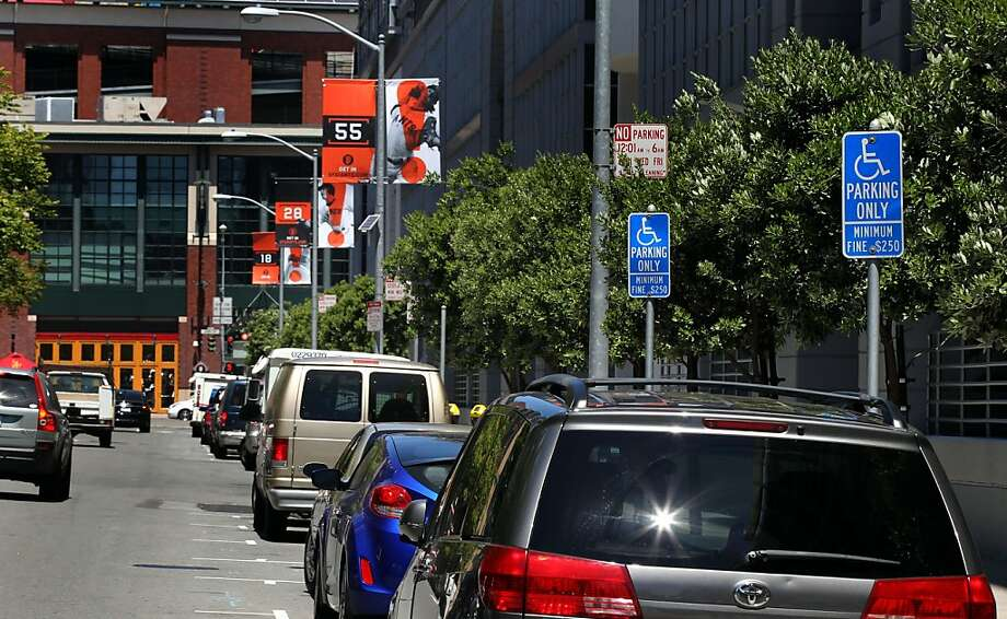 Thousands of cars park round AT&T Park on game day allowing dozens of disabled parking permits to be used on a number of limited handicapped spaces Wednesday June 27, 2012 at AT&T Park in San Francisco Calif. Photo: Lance Iversen, The Chronicle