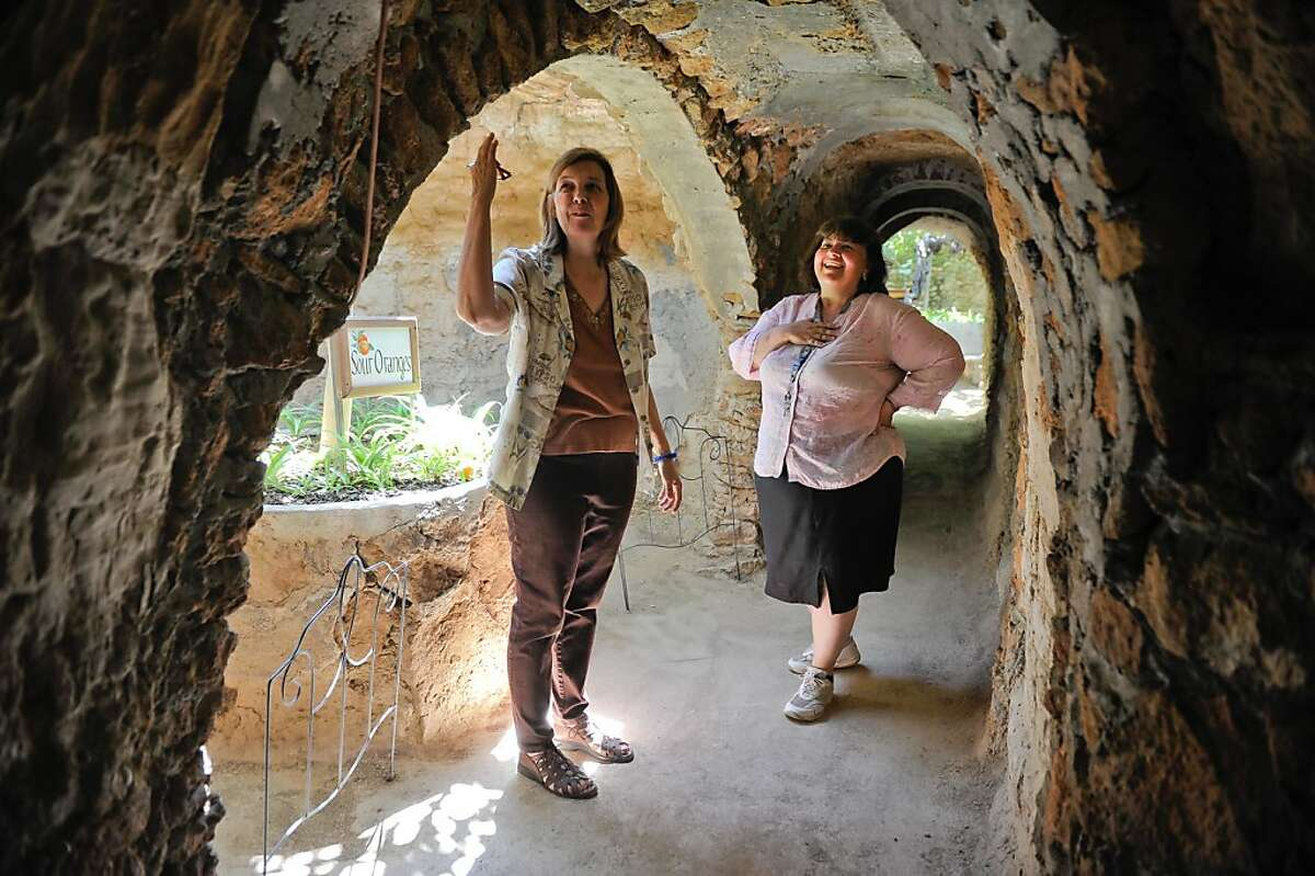 Lyn Forestiere Kosewski, left, and her sister Valery Forestiere walk through the tunnels in the Forestiere Underground Gardens, an elaborate network of underground rooms, tunnels and gardens built over 100 years ago by their great uncle Sicilian immigrant Baldassare Forestiere, on Tuesday, June 12, 2012, in Fresno, Calif. Baldassare Forestiere's descendants fear that construction of the high speed rail project will worsen their already encroached space by further restricting access to the landmark, increasing noise and pollution levels, and causing damage to the century old landmark.
