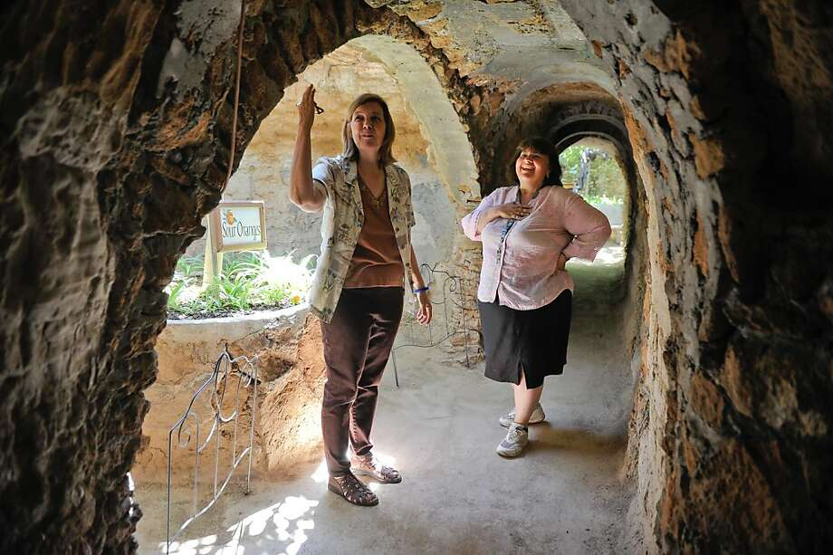 Lyn Forestiere Kosewski, left, and her sister Valery Forestiere walk through the tunnels in the Forestiere Underground Gardens, an elaborate network of underground rooms, tunnels and gardens built over 100 years ago by their great uncle Sicilian immigrant Baldassare Forestiere, on Tuesday, June 12, 2012, in Fresno, Calif.  Baldassare Forestiere's descendants fear that construction of the high speed rail project will worsen their already encroached space by further restricting access to the landmark, increasing noise and pollution levels, and causing damage to the century old landmark. Photo: Silvia Flores, Special To The Chronicle