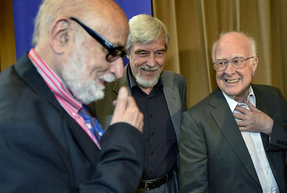 Francois Englert, Rolf Heuer, Director General of CERN, and Peter Higgs in Meyrin near Geneva on Wednesday. Photo: Martial Trezzini, Associated Press