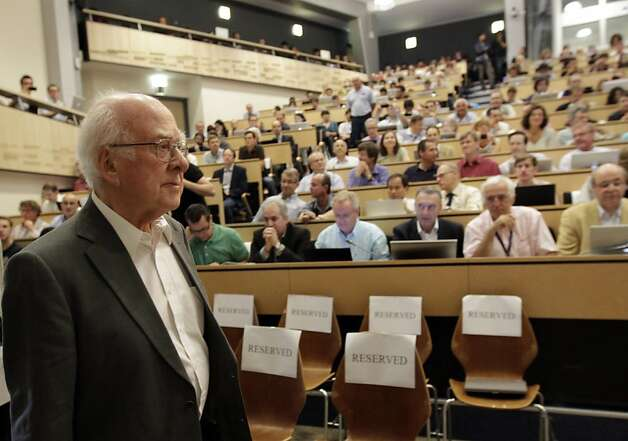 "British physicist Peter Higgs arrives for a scientific seminar to deliver the latest update in the search for the Higgs boson at the European Organization for Nuclear Research (CERN) in Meyrin near Geneva, Switzerland, Wednesday, July 4, 2012. The head of the world's biggest atom smasher is claiming discovery of a new particle that he says is consistent with the long-sought Higgs boson known popularly as the ""God particle"" which is believed to give all matter in the universe size and shape. (AP Photo/Denis Balibouse, Pool) Photo: Denis Balibouse, Associated Press"