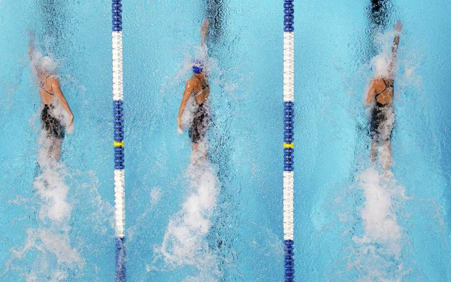Kara Lynn Joyce, from left, Dara Torres and Jessica Hardy compete in the women's 50-meter freestyle final at the U.S. Olympic swimming trials, Monday, July 2, 2012, in Omaha, Neb. Hardy won the final. (AP Photo/Mark Humphrey) Photo: Associated Press