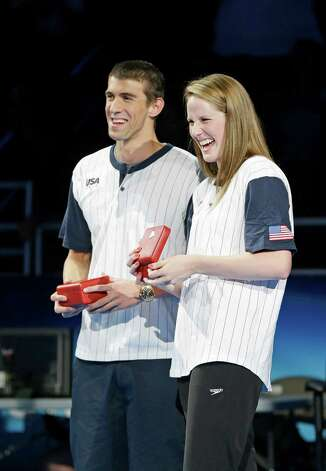 Michael Phelps and Missy Franklin laugh after receiving Omega High Point awards during the closing ceremony at the U.S. Olympic swimming trials on Monday, July 2, 2012, in Omaha, Neb. (AP Photo/Mark Humphrey) Photo: Associated Press