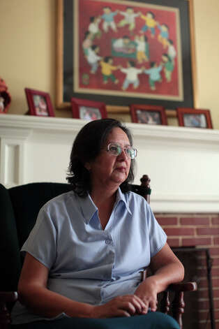 Irma Mireles sits in a living room at Visitation House, where she is the office manager, in San Antonio on Wednesday, June 27, 2012. Photo: Lisa Krantz, San Antonio Express-News / San Antonio Express-News