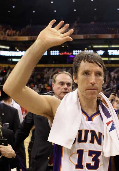 PHOENIX, AZ - APRIL 25:  Steve Nash #13 of the Phoenix Suns waves to fans as he walks off the court following the NBA game against the San Antonio Spurs at US Airways Center on April 25, 2012 in Phoenix, Arizona.  The Spurs defeated the Suns 110-106.  NOTE TO USER: User expressly acknowledges and agrees that, by downloading and or using this photograph, User is consenting to the terms and conditions of the Getty Images License Agreement. Photo: Christian Petersen, Getty Images / 2012 Getty Images