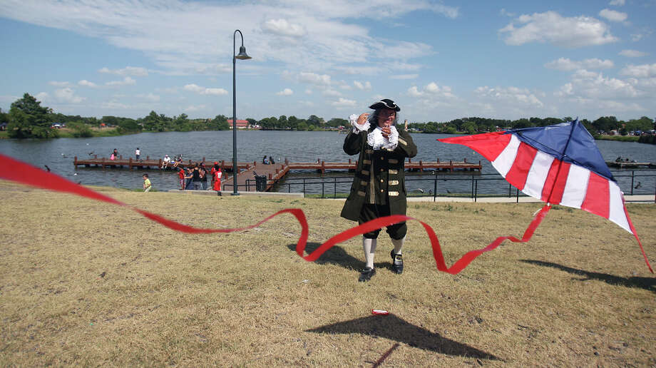 Roy Mendoza, dressed as Benjamin Franklin, flies a kite in the spirit of the Fourth of July Wednesday July 4, 2012 at Woodlawn Lake Park. Photo: Julysa Sosa / SAN ANTONIO EXPRESS-NEWS