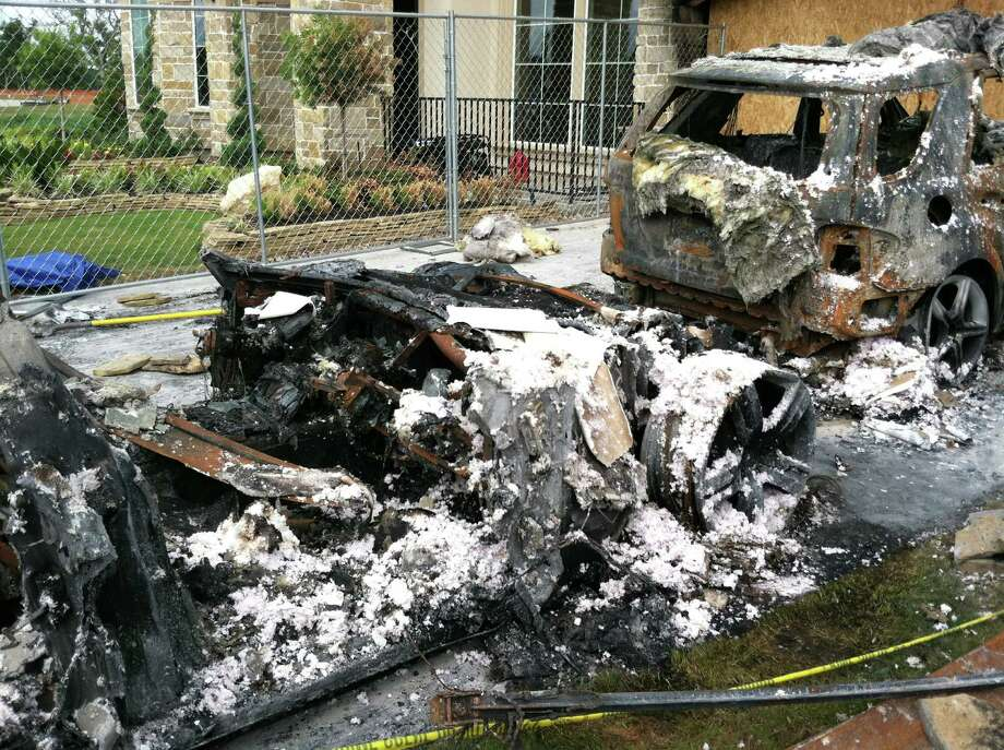 A brand-new Fisker Karma (foreground), purchased from Miller Motorcars in Greenwich, was the source of a fire that destroyed a Houston-area home's garage where it was parked, according to a fire official. Various investigations into what sparked the blaze are ongoing. Photo: Contributed Photo
