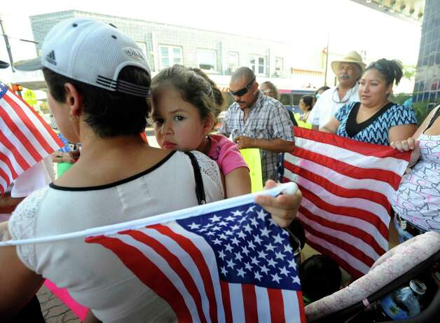 Ariana Perez is held in the arms of her mother during a rally at the Guadalupe Theatre before the second annual March for Immigrant Rights in San Antonio on Wednesday, July 4, 2012. Photo: Billy Calzada, San Antonio Express-News / © 2012 San Antonio Express-News