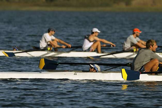 Coxswain Zach Vlahos of Piedmont, center, leads one of the four boats as the U.S. Olympic rowing team men's 8 team practices on Briones Reservoir on Wednesday, July 4, 2012, in Orinda, Calif. Photo: Carlos Avila Gonzalez, The Chronicle