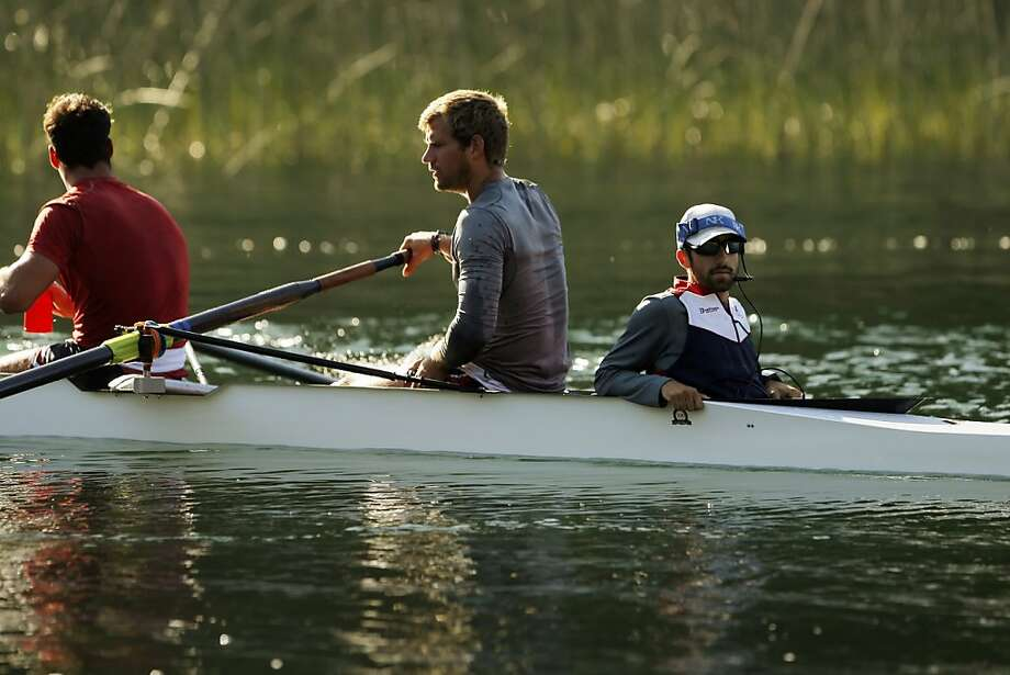 Zach Vlahos, right, pops up during a break as the rowing team practices on Briones Reservoir on Wednesday in Orinda. Photo: Carlos Avila Gonzalez, The Chronicle