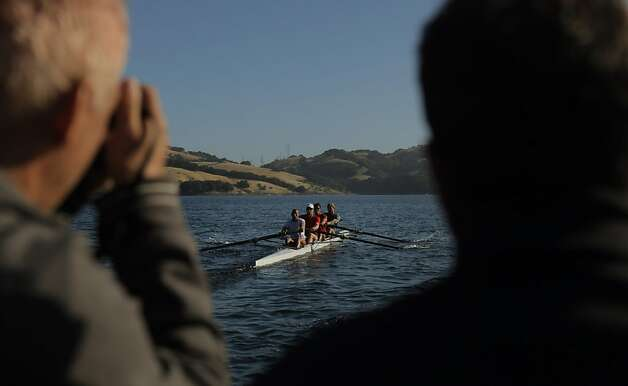 Bernhard Stomporowski, left, and coach Mike Teti watch from the launch as the U.S. Olympic rowing team men's 8 practices in two 4 boats on Briones Reservoir on Wednesday, July 4, 2012, in Orinda, Calif. Photo: Carlos Avila Gonzalez, The Chronicle