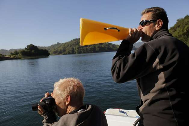 Coach Mike Teti, right, speaks to the coxswains as Bernhard Stomporowski photographs the boats as the U.S. Olympic rowing team men's 8 practices on Briones Reservoir on Wednesday, July 4, 2012, in Orinda, Calif. Photo: Carlos Avila Gonzalez, The Chronicle