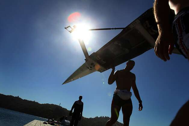 "Members of the U.S. Olympic rowing team men's ""eight"" team, carries the boat back to the boathouse after practice on Briones Reservoir on Wednesday, July 4, 2012, in Orinda, Calif. Photo: Carlos Avila Gonzalez, The Chronicle"