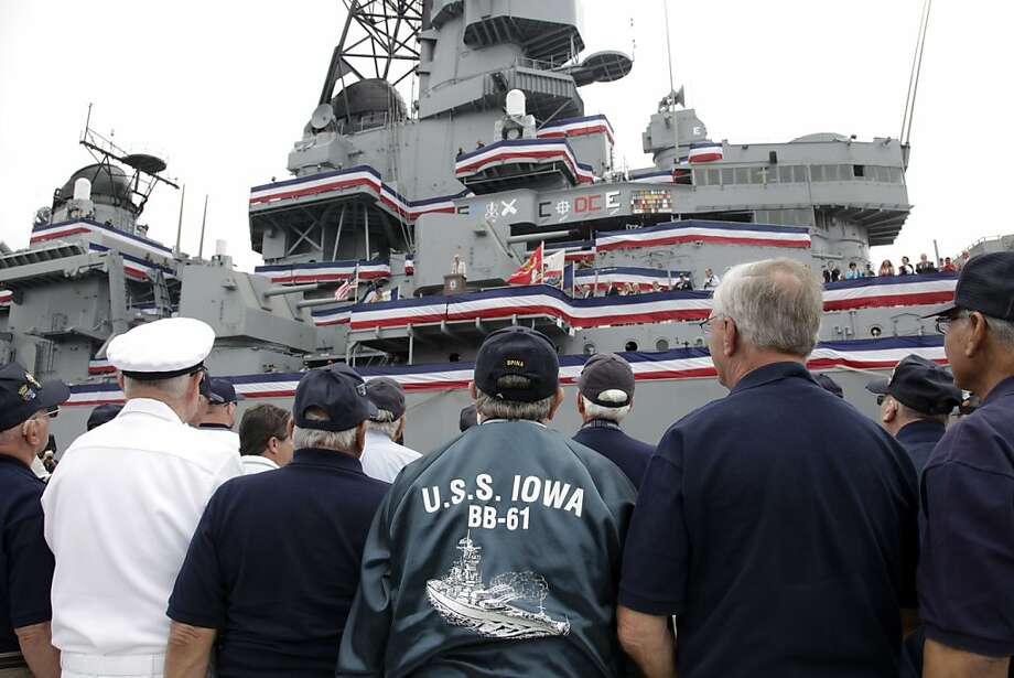 Veterans and former crew members watch as congresswoman Janice Hahn, talks during the commissioning ceremony for the battleship USS Iowa as a memorial and an educational museum at the Port of Los Angeles in San Pedro, Calif. on Wednesday, July 4,2012. The ship, built in 1940, arrived in Los Angeles in May and will be permanently stationed in the port and operated as a floating museum. (AP Photo/Richard Vogel) Photo: Richard Vogel, Associated Press