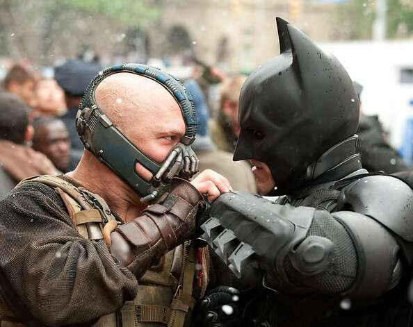 "Tom Hardy's Bane faces off against Christian Bale's Batman in ""The Dark Knight Rises."" Photo: Ron Phillips"