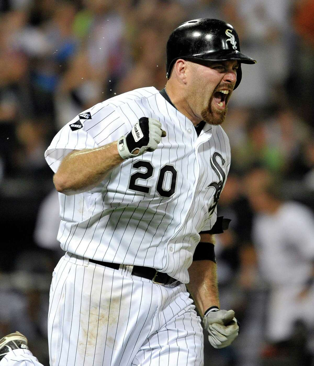 Kevin Youkilis' RBI single in the 10th lifted the White Sox past the Rangers.