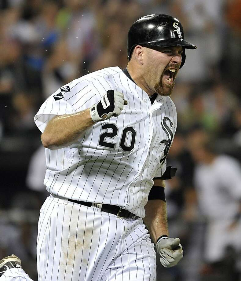 Chicago White Sox's Kevin Youkilis reacts as he runs up the first base line after hitting a game-winning RBI single, scoring Alejandro De Aza, during the tenth inning of a baseball game against the Texas Rangers, Wednesday, July 4, 2012, in Chicago. The White Sox won 5-4 in 10 innings. (AP Photo/Brian Kersey) Photo: Brian Kersey, Associated Press