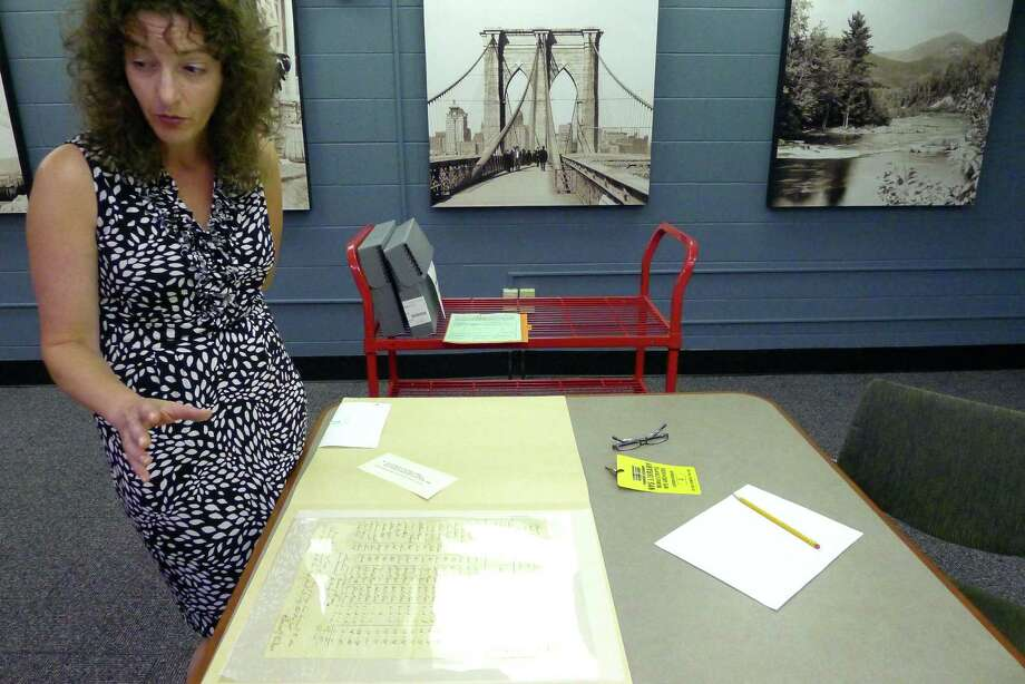 Tricia Barbagallo, an independent researcher and UAlbany Ph.D. candidate, is working with records and documents from former slaves in Albany, who celebrated Independence Day on July 5 and records of slaves buying freedom for their family members at the NYS Library in Albany NY Friday June 22, 2012. (Michael P. Farrell/Times Union) Photo: Michael P. Farrell / 00018209A