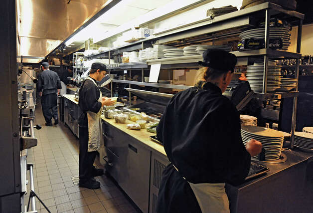 Cooks prep in the kitchen for the evening dinner crowd at 677 Prime on Broadway Tuesday, July 3, 2012 in Albany, N.Y. The new state per diem rules could affect the local hospitality business. (Lori Van Buren / Times Union) Photo: Lori Van Buren