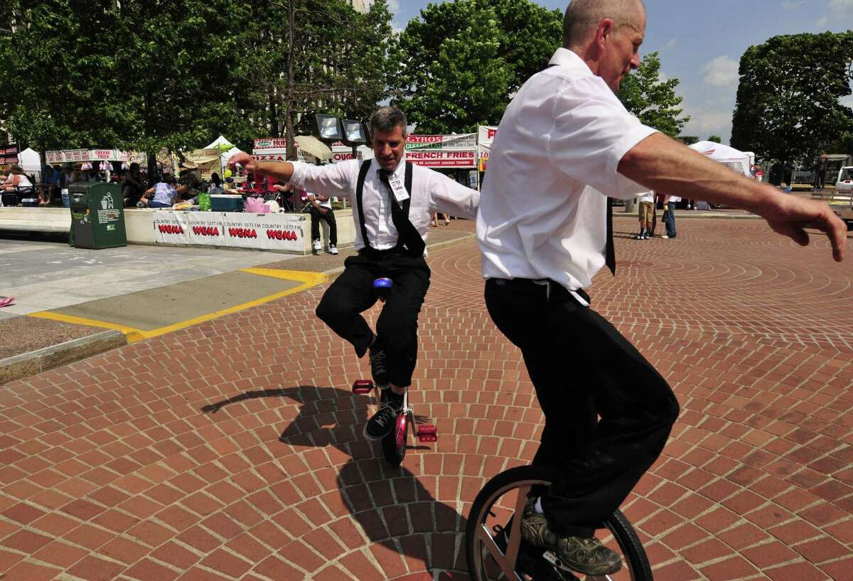 Pat Ferri , on a unicycle left, and Jim owen riding a ultama wheel entertain during the Price Chopper 4th of July celebration at the Empire State Plaza in Albany N.Y.Wednesday July 4, 2012. (Michael P. Farrell/Times Union)