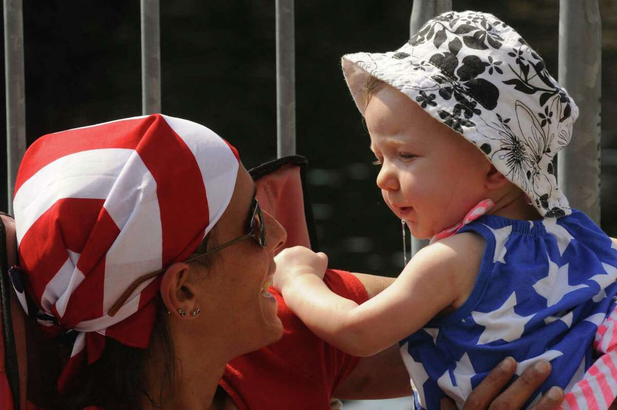 Alithia Ortega and her 6-month-daughter Scarlette Ortega of Amsterdam enjoy a connection during the Price Chopper 4th of July celebration at the Empire State Plaza in Albany N.Y.Wednesday July 4, 2012. (Michael P. Farrell/Times Union)