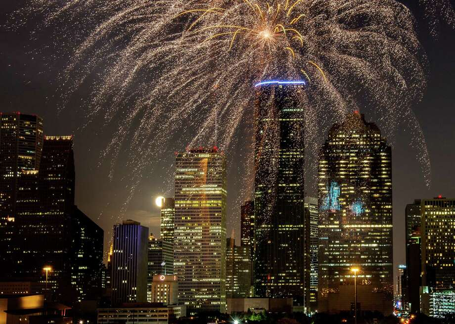 Fireworks explode as a full moon rises over the downtown skyline during the Freedom Over Texas annual Fourth of July celebration on Wednesday, July 4, 2012, in Houston. Photo: Smiley N. Pool, Houston Chronicle / © 2012  Houston Chronicle