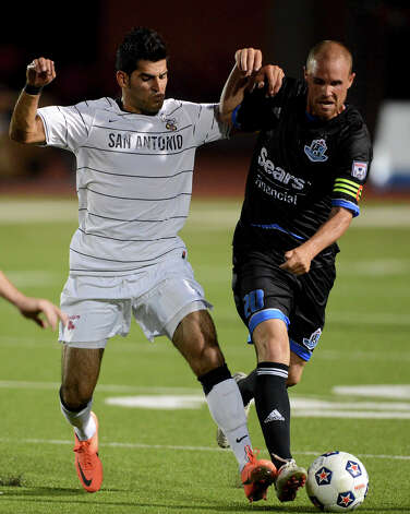 Scorpions forward Esteban Bayona (11) battles the Edmonton Eddies' Chris Kooy (20) for control of the ball during the teams' match on Wednesday, July 4, 2012, at Heroes Stadium. Photo: John Albright, For The Express-News