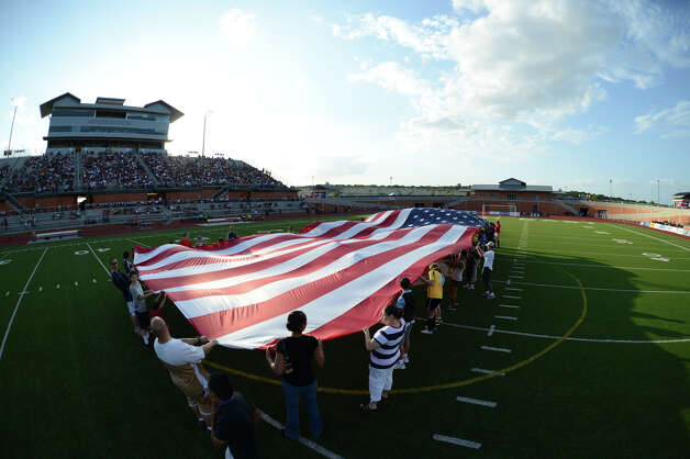 A giant American Flag is held on the center of the field before a match between the San Antonio Scorpions and the Edmonton Eddies on Wednesday, July 4, 2012, at Heroes Stadium. Photo: John Albright, For The Express-News