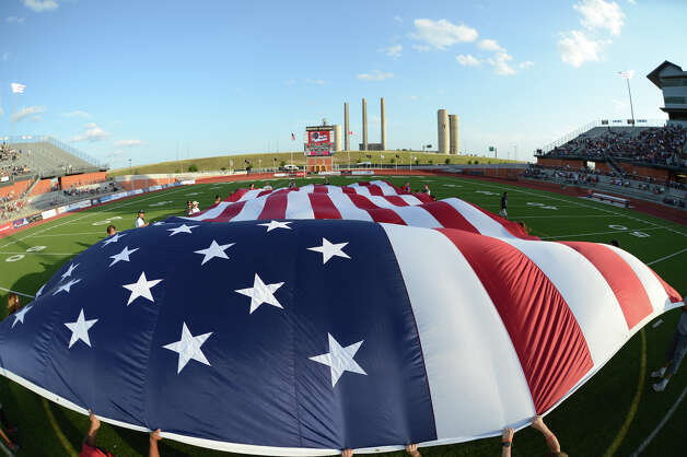 A giant American flag is unfurled across the field before the Scorpions' game against FC Edmonton on Wednesday at Heroes Stadium. Photo: John Albright, For The Express-News