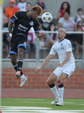 The Edmonton Eddies' Fabien Vorbe (27) heads the ball away from Scorpions forward Hans Denissen (10) during the teams' match on Wednesday, July 4, 2012, at Heroes Stadium. Photo: John Albright, For The Express-News