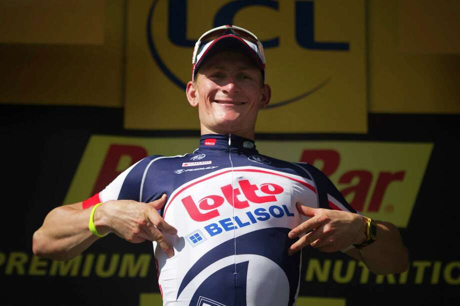 Stage winner, Germany's Andre Greipel celebrates on the podium at the end of the 214,5 km and fourth stage of the 2012 Tour de France cycling race starting in Abbeville and finishing in Rouen, northwestern France, on July 4, 2012.  AFP PHOTO / LIONEL BONAVENTURELIONEL BONAVENTURE/AFP/GettyImages Photo: LIONEL BONAVENTURE / AFP